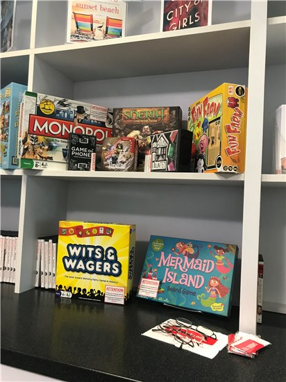 photo of board games on shelf